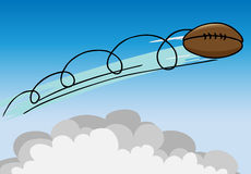 Flying Football. American football flies high above the clouds Royalty Free Stock Image