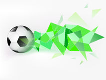 Flying football ball with abstract green triangle shoot  Stock Image
