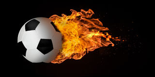 Flying Football or Soccer Ball Engulfed in Flames. Flying football or soccer ball engulfed in trailing flames with sparks flying on a black background. Concept Royalty Free Stock Photo