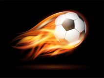 Flying football or soccer ball on fire. Flying football on fire. Soccer ball with bright flame trail on the black background Stock Photo