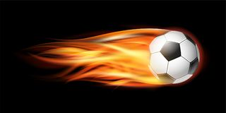 Flying football or soccer ball on fire. Flying football on fire. Soccer ball with bright flame trail on the black background Royalty Free Stock Photography