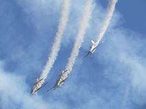 Flying in formation. Airplanes in flight at an air show Stock Photos
