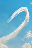 Flying in Formation. Six jets trailing smoke complete a tight loop while flying in a diamond formation during an airshow Stock Photos