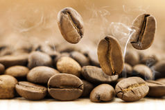 Flying fresh coffee beans as a background with copy space. Coffe Royalty Free Stock Photo