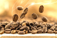 Flying fresh coffee beans as a background with copy space. Coffe Stock Image