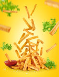Flying fried potatoes, lettuce and ketchup. French fries. Royalty Free Stock Images