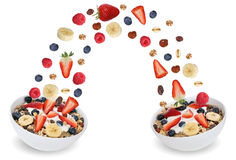 Flying fruit muesli for breakfast in bowl with fruits like banan Royalty Free Stock Images