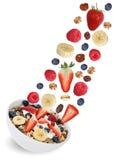 Flying fruit muesli with fruits like raspberry, banana and straw Stock Photos
