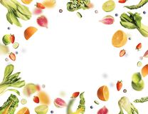 Flying fruits and vegetables ingredients on white stock photos