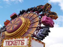 Flying fun. Brightly coloured spinning wheel ride at a carnival Stock Photography