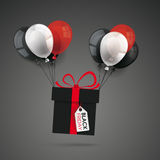 Flying Gift Black FridayBalloons Price Sticker. Black gift with red ribbon, price sticker and colored balloons on the dark background Royalty Free Stock Image