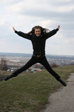 Flying girl. Cheerful girl is flying in the air Stock Photography