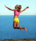 Flying Girl Against The Sea Royalty Free Stock Photo