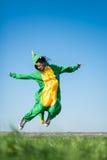Flying girl dragon kigurumi. Dragon kigurumi on the green fild, girl, portrait Stock Image