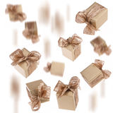Flying gold gifts background Royalty Free Stock Image