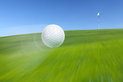 Flying golf ball Royalty Free Stock Image