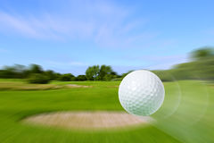 Flying golf ball Royalty Free Stock Photos