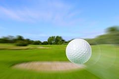 Flying golf ball Royalty Free Stock Photos