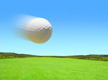 Flying golf ball. Stock Photos