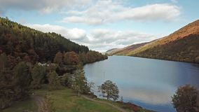 Flying through the Great Glen above Loch Oich towards Loch Ness in the scottish highlands - United Kingdom.  stock video footage