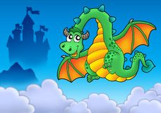 Flying green dragon with castle Royalty Free Stock Photo