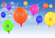 Flying group of balloons, concept of sale message for shop Royalty Free Stock Images