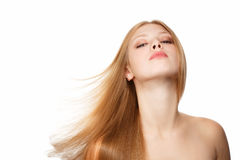 Flying hair. Young beautiful woman with long blond hair flying isolated on white background Stock Images