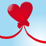 Flying Heart-shaped balloon Stock Photo