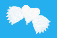 flying heart shaped cloud on blue sky Stock Photos