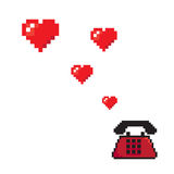 Flying hearts from old telephone pixels art style Stock Photos