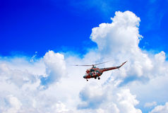 Flying helicopter. Against blue sky Royalty Free Stock Photo