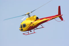 Flying Helicopter. A helicopter swings to the left after taking off Royalty Free Stock Photos
