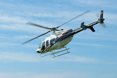 Flying a helicopter Bell 407GX (RA-01605) close-up Royalty Free Stock Photo