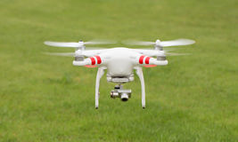 Flying helicopter with camera Royalty Free Stock Images