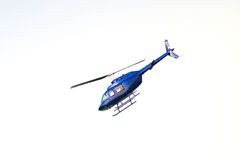 Flying helicopter isolated on white Stock Images