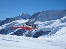 Flying Helicopter at Jungfrau Top of Europe Royalty Free Stock Photos