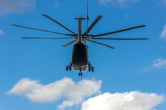 Flying helicopter in the sky royalty free stock image