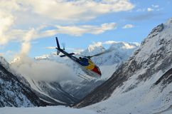 Flying helicopter between mountains in the Himalayas Stock Images