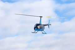 Flying helicopter Stock Photography