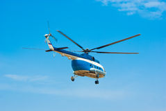 Flying a helicopter in sky Stock Image