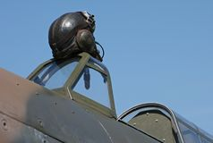 Flying helmet. Vintage leather pilot's flying helmet, on cockpit of WWII fighter aircraft Royalty Free Stock Photography