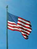 Flying High. American flag waving in the wind Royalty Free Stock Photo
