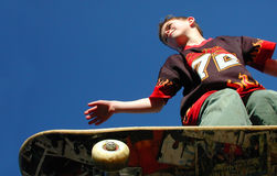 Flying High. Extreme skateboarder flies high Stock Image