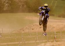 Flying High. Motocross rider in mid air Royalty Free Stock Photo