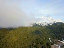 Flying high above Alaskas Chugach mountains stock photo