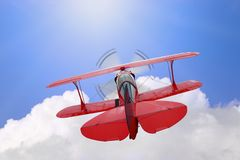 Flying high above the clouds. A red biplane flying high above the clouds towards the sun, good concept image for the phrase Flying high Vector Illustration