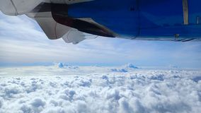 Flying high above the clouds over the Atlantic Ocean stock photos