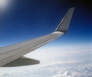 Flying high above the earth. Aerial view of sky from aircraft window Stock Image