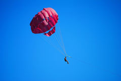 Flying high on the parachute Stock Photo