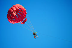 Flying high on the parachute Stock Image